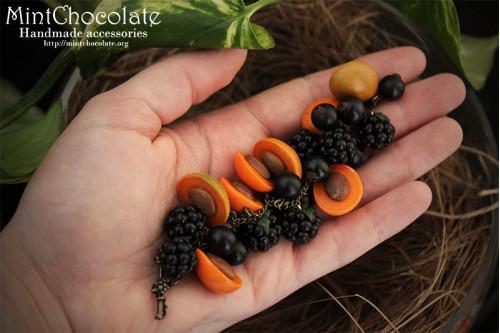 Apricots in black bracelet