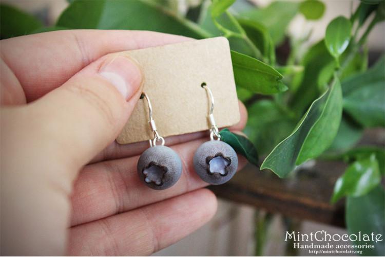 Asymmetric blueberry earrings